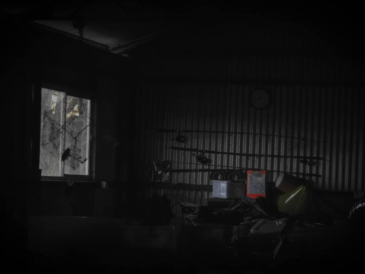 dark room with a window
