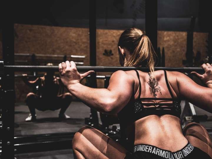 woman performing a squat